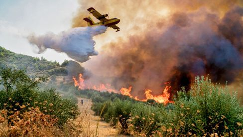 Firefighting plane tries to extinguish fires in Peloponnese, Greece,